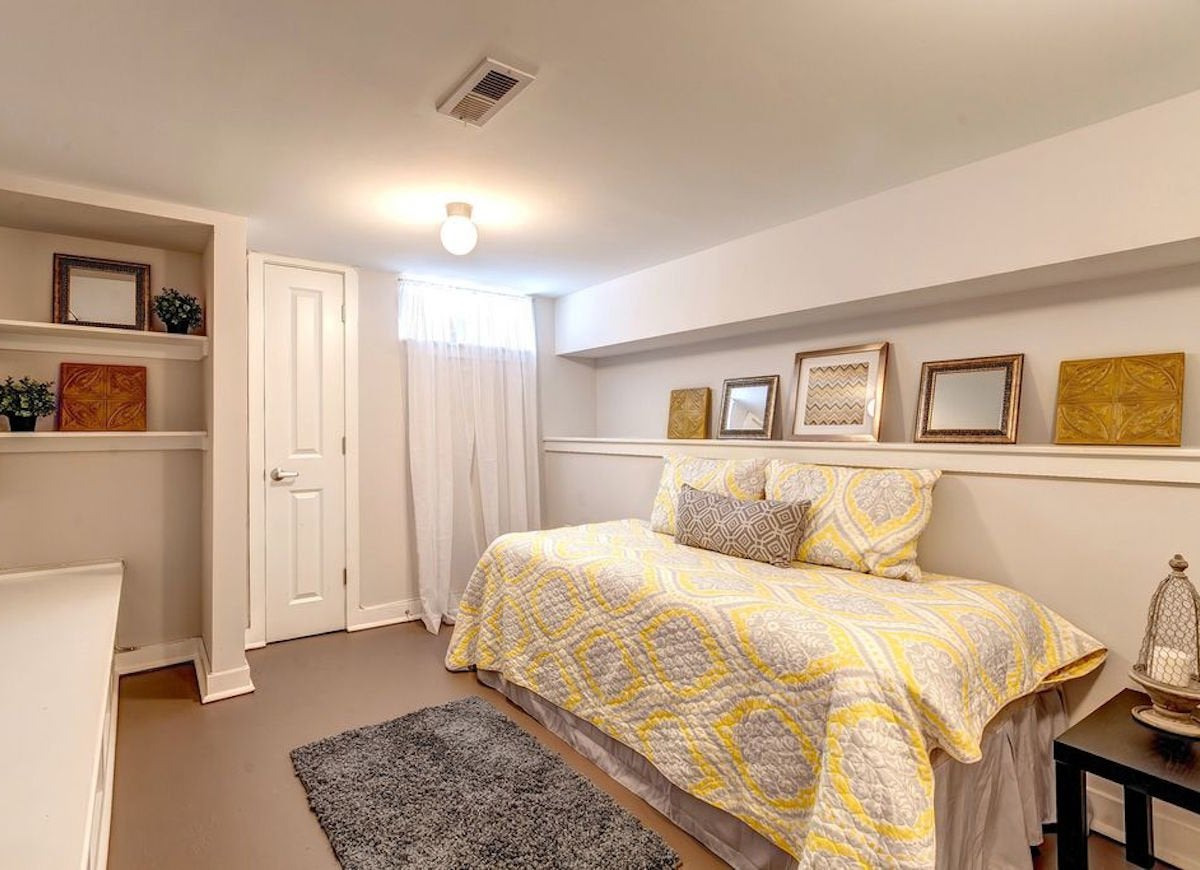 Basement Bedroom Perfect For A Nap! Off-white Walls Get A Visual Boost From Soft Gray And  Yellow Accents. This Narrow Basement Bedroom Is Surprisingly Lovely With  Its Clean ...