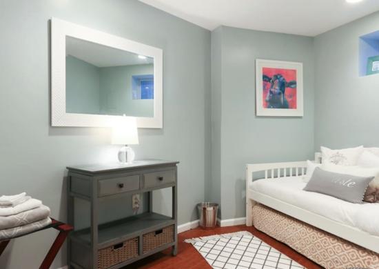 Mint green basement bedroom
