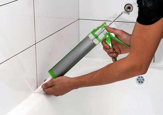 Caulk bathroom tiles