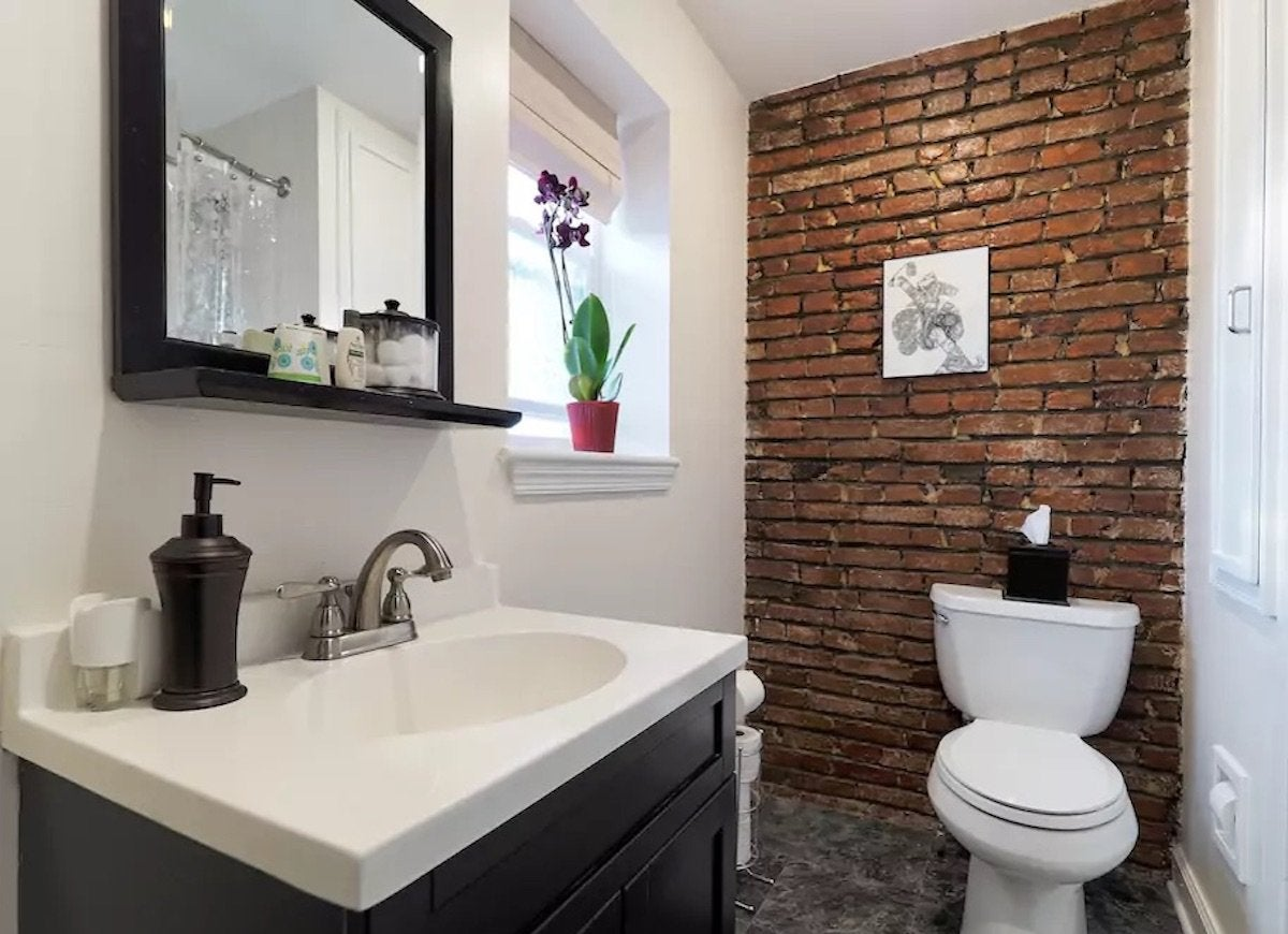 red brick bathroom - exposed brick - 14 reasons to love the look