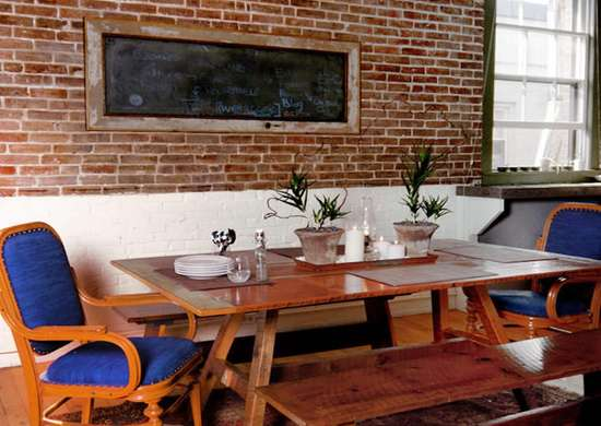 Exposed brick dining room