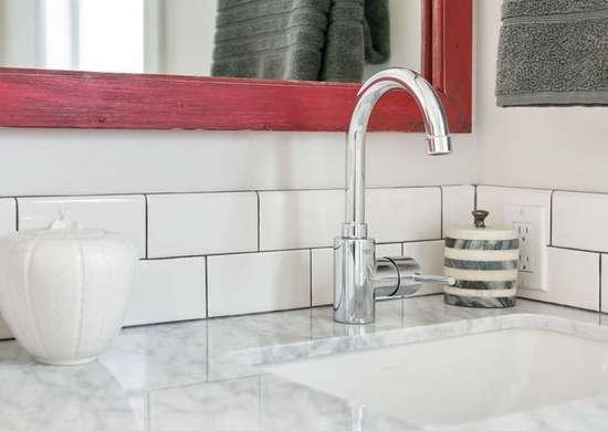 White Subway Tile And Carrara Marble Bathroom
