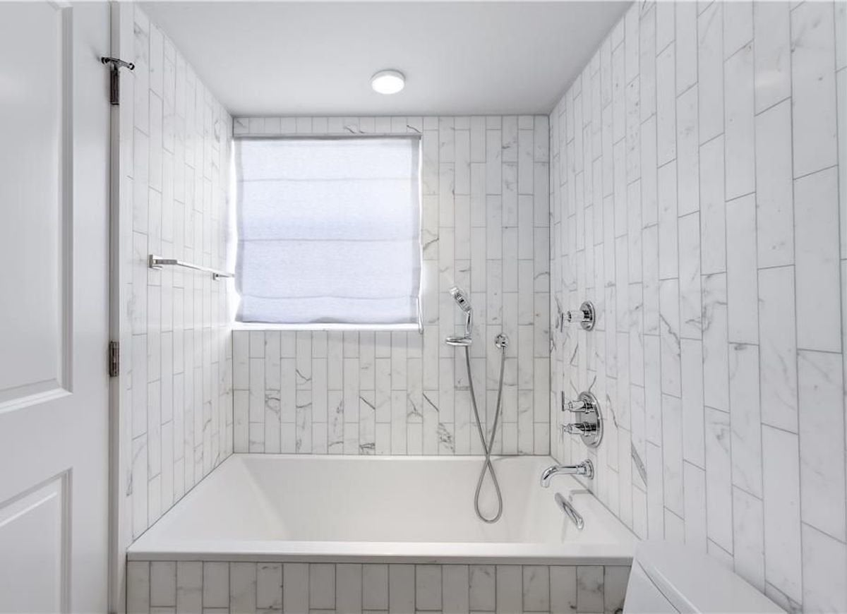 Subway tile 16 new reasons to love the look bob vila subway tile taller laid out in a vertical pattern dailygadgetfo Gallery