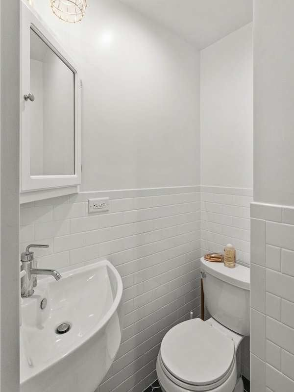 Small Bathroom with Corner Sink