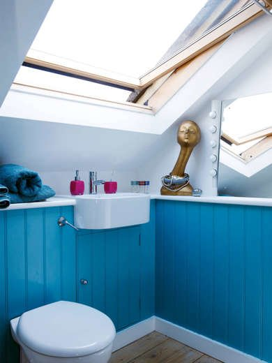 Small Bathroom with Blue Cabinets