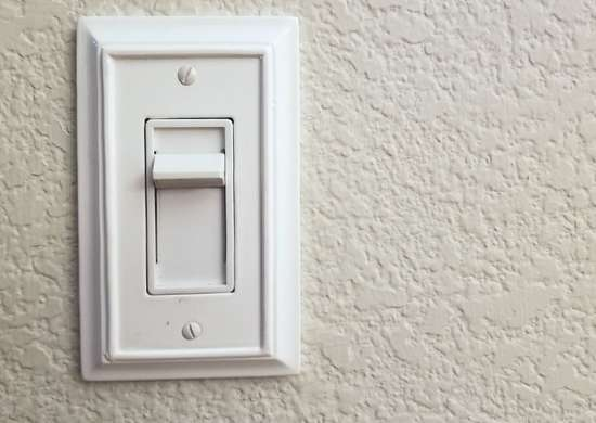 Replace standard switches with dimmer switches.
