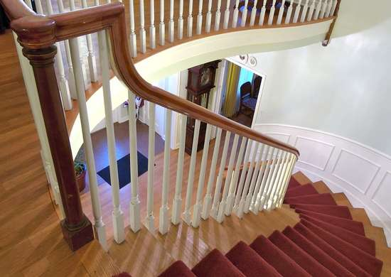 Update a wooden staircase with carpet treads.