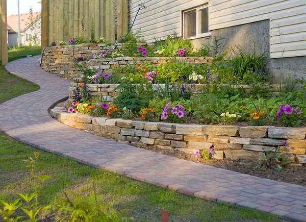 Backyard Slope Landscaping Ideas - 10 Things To Do - Bob Vila on fencing vegetable garden, brick vegetable garden, railroad tie rose garden, retaining wall vegetable garden, home vegetable garden, raised bed vegetable garden, railroad tie raised garden, backyard vegetable garden, tree branch vegetable garden, pvc vegetable garden, railroad tie garden boxes, railroad sidewalk ideas, railroad ties for landscaping, stone vegetable garden, milk crate vegetable garden, concrete vegetable garden, rock vegetable garden, wood vegetable garden, railroad tie garden steps, metal vegetable garden,