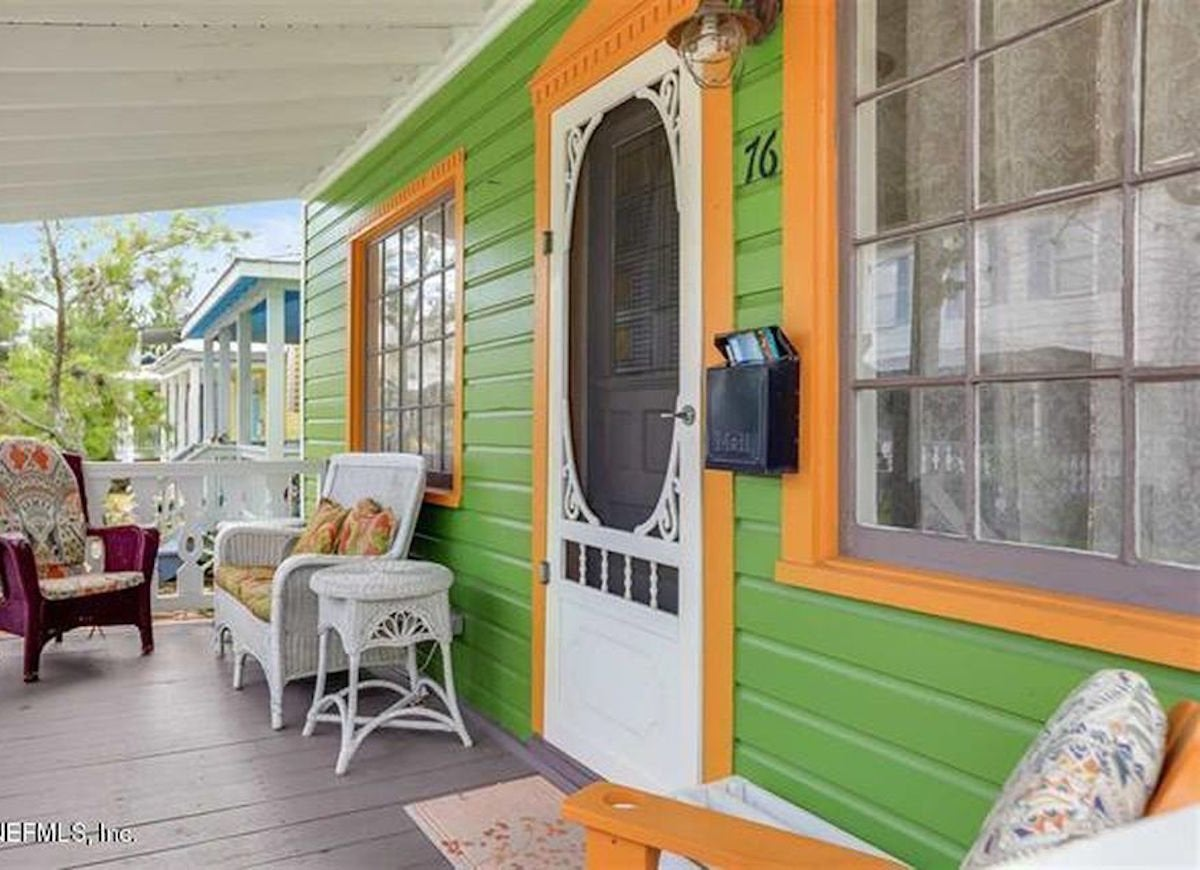 The Front Entry Door Of This Unconventionally Colored Home Is Covered With A Vintage Screen That Complements S Quirky Aesthetic And Showcases