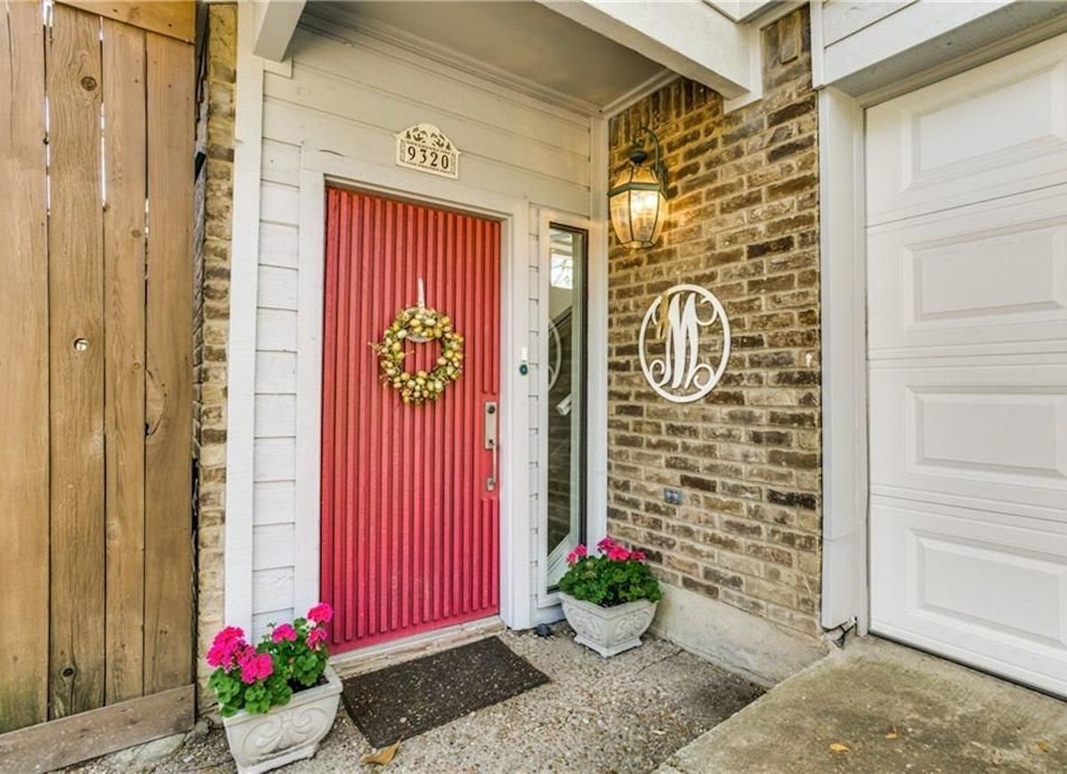Vertical Stripes Of Raised Wood Adorn This Front Door For A Unique Look That Sets It Apart From The Rest Houses On Street