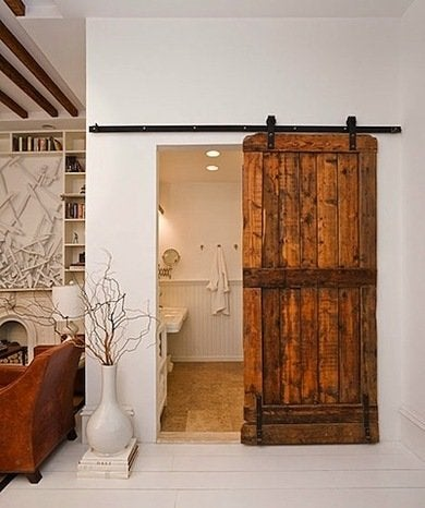 this brooklyn home company designed bathroom door originally comes from a sheep barn in new england black flat track hardware is a contemporary contrast to - Barn Door Design Ideas