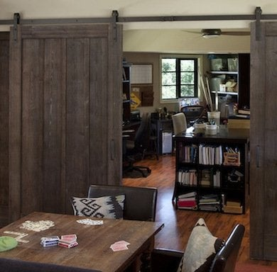 californiabased designer tineke triggs of artistic designs for living uses beautifully stained doors on flat bar hardware to separate a home office from barn o