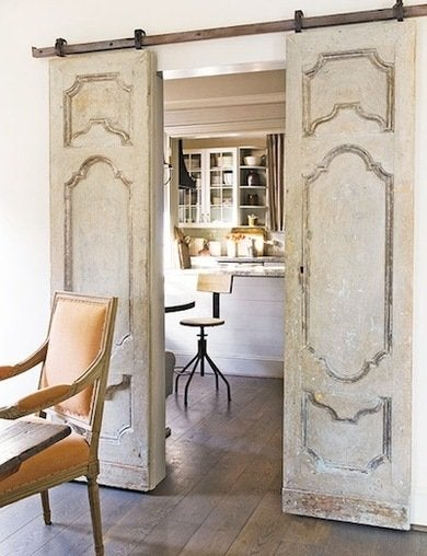 in this houston home antique swinging doors get new life as space saving sliding doors between the dining room and kitchen - Barn Door Design Ideas
