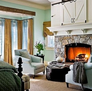 even small doors can benefit from a hanging treatment a media cabinet installed above a fireplace can be hidden away by rolling barn style doors