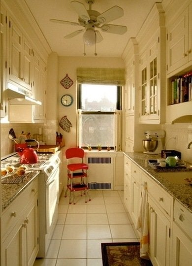 Ceiling high cabinets topped with traditional  stacked crown molding make  the most of the vertical space in this small galley kitchen. Galley Kitchen Design Ideas   16 Gorgeous Spaces   Bob Vila
