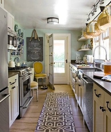 Some galley kitchens suffer from narrow aisles, but in this relatively  spacious example, multiple cooks can work comfortably side by side.