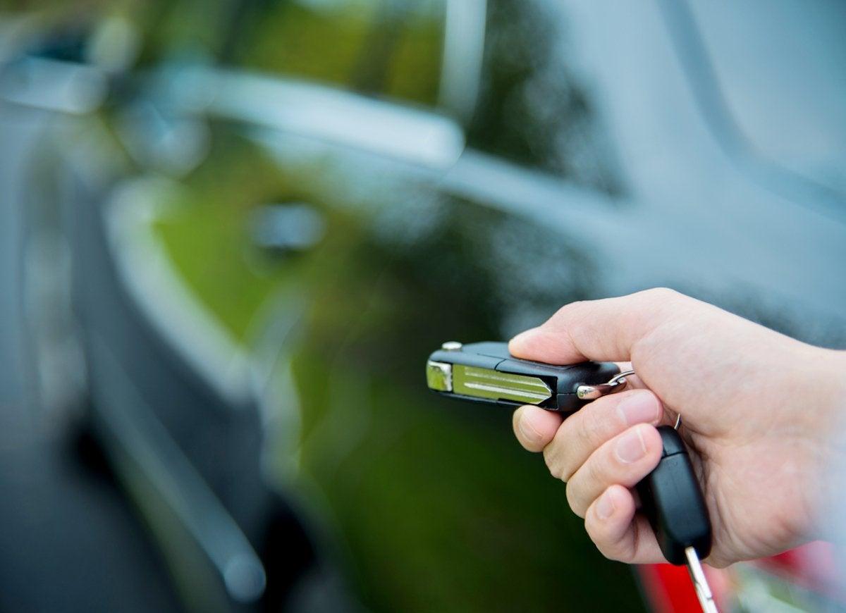 Hand unlocking a car