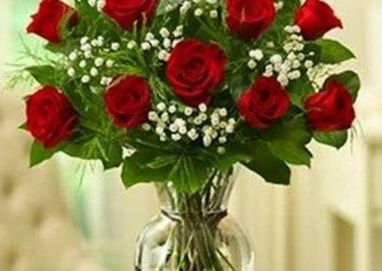 Long stem red roses in vase romansflorist