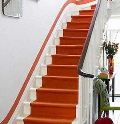 Orange painted staircase fabulousonabudget