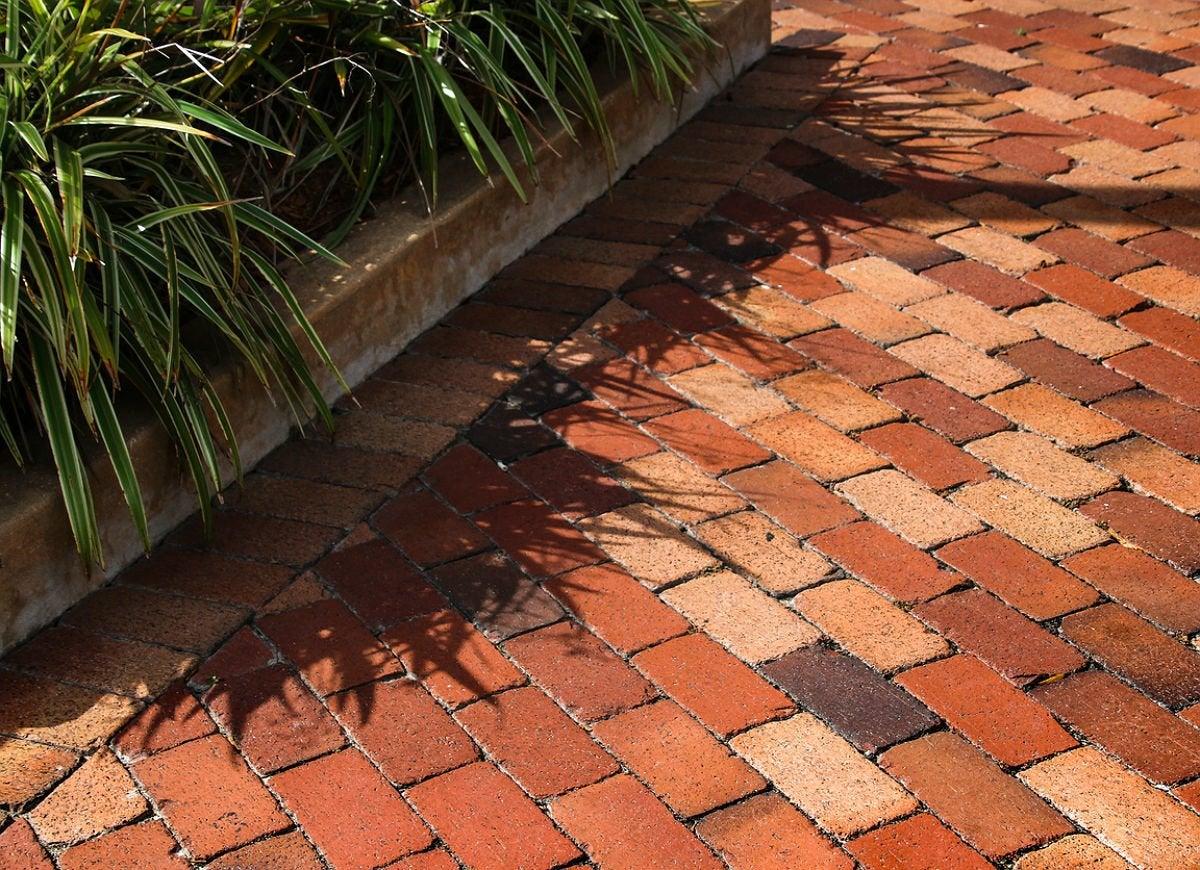 9 Brick Patio Ideas for a Beautiful Backyard | Bob Vila ... on Backyard Brick Patio id=12394