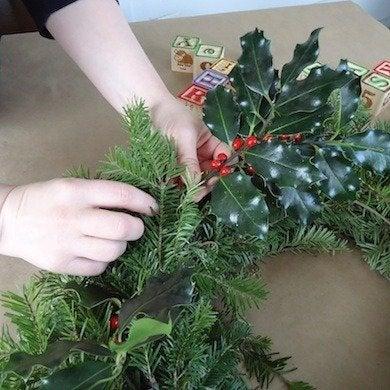 Tuck holly in wreath