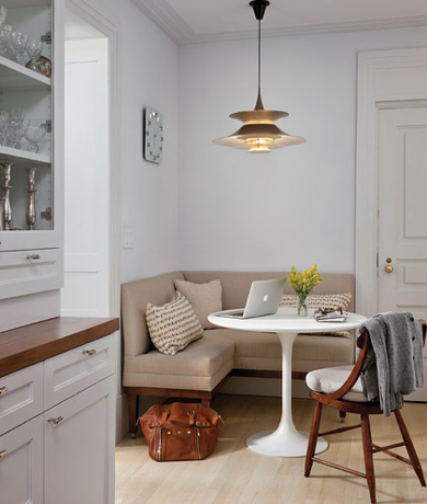 Alcoves Bay Windows And Unused Corners Are All Good Spots For A Banquette Upholstered Benches Simple Pedestal Table Transform This Cozy Corner Into