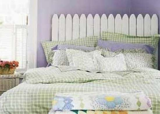 Section Of Picket Fencing Becomes A Charming Headboard Paired With Quilts And Wicker It Sets Folksy Fanciful Tone In This Cottage Style Bedroom