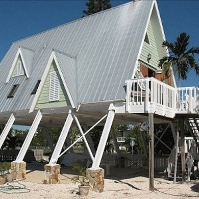 A frame house designs 10 that deserve a bob vila for Elevated beach house