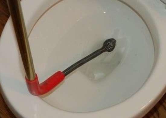 Toilet auger insert
