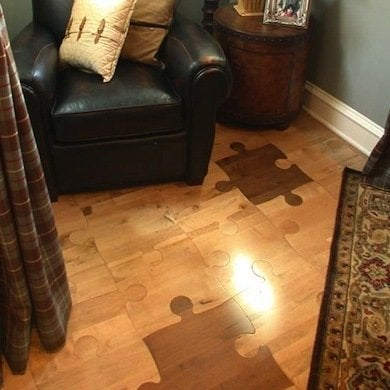 Cheap flooring ideas 15 totally unexpected diy options bob vila these fun hardwood look floor tiles are like childs play for the do it yourself crowd the floating floor jigsaw pattern pieces click together like solutioingenieria Choice Image
