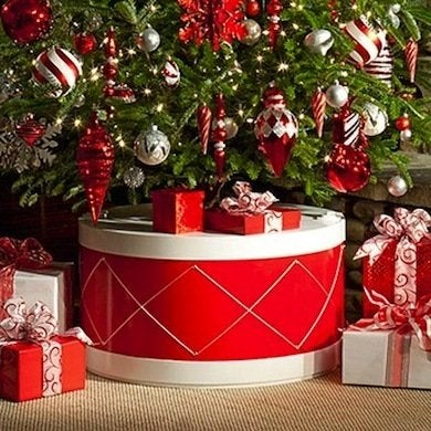 encase the base of your tree in a festive holiday drum with a jigsaw some plywood and the will to diy this cheerful stand can be yours