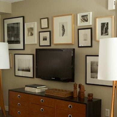 Make Use Of A Large Wall E By Creating Gallery That Includes The Television Hidden In Plain Sight Among Prints Paintings And Photos
