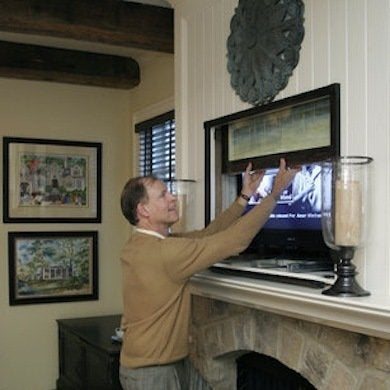 How to hide a flat screen tv 9 ways to make your look at for Tv in furniture hidden