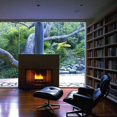 Reading by fireplace