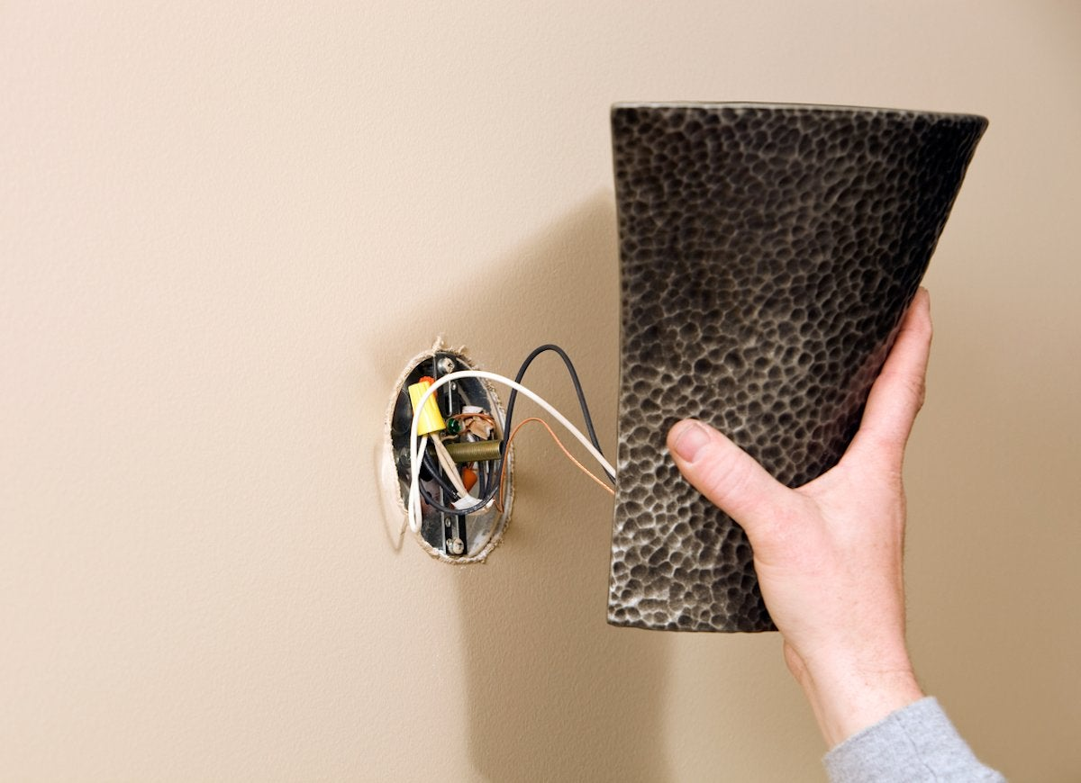 30 Things Every Homeowner Should Know How To Do Bob Vila Wiring Wall Sconce A Adds Instant Style And Can Make Room Look Taller Install Cut Squares Into The Drywall Just Large Enough Fit An Electrical Box
