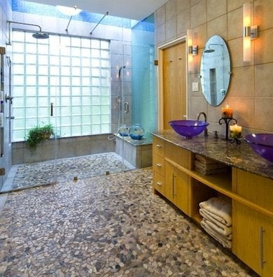 Bathroom flooring ideas fresh ideas beyond tile bob vila with natural stone pebble flooring you can bring the outdoors inside and imagine yourself bathing al fresco pebble flooring is affixed to the subfloor or solutioingenieria Images