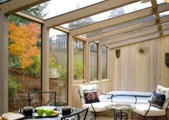 A Hot Tub In This Sunroom Guarantees That You Ll Want To Spend As Much Time Can Out There Gl Topped Wrought Iron Tables Colorful Rug