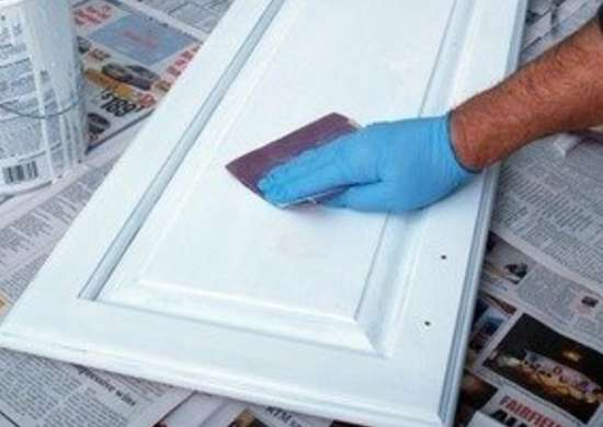 How to Paint Kitchen Cabinets - Sand Primed Surface