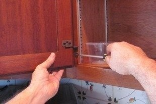 Jprovey-removing-hinges-how-to-paint-kitchen-cabinets-bob-vila