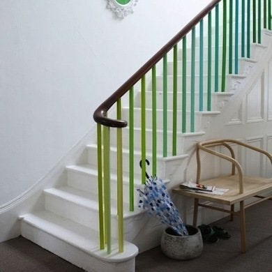 A Seemingly Ordinary Staircase Railing Is Made Extraordinary By Painting The Baers Varying Vibrant Shades Of Color With Rest