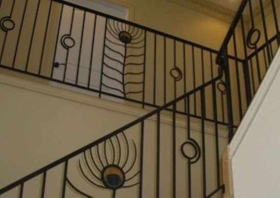 Stained Gl Enhances This Custom Made Railing S Pea Feather Design The Eyes Of Iron Feathers Are Echoed By Circular Accents