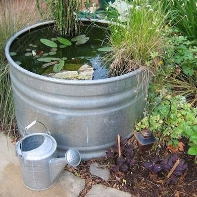Backyard ponds 10 stunning water feature designs bob vila for Outdoor pond tub