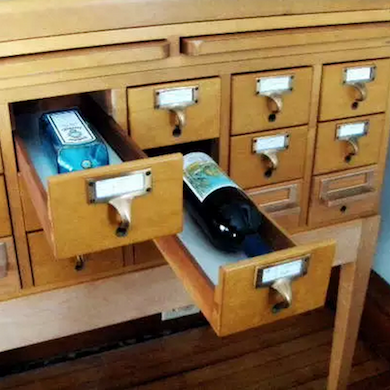 this clever idea repurposes a library card catalog to store liquor
