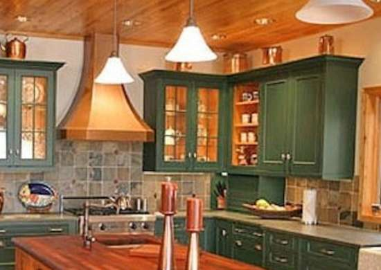 These Green Painted Cabinets Contrast Beautifully With The Wood Paneled Ceiling And Butcher Block Topped Center Island Of This Rustic Kitchen
