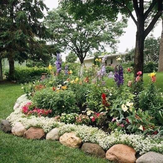 Diy garden edging bob vila river rock garden edging solutioingenieria Images