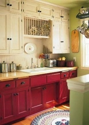... be afraid to switch up your paint colors. The cranberry-colored base  cabinets and cream wall-hung units add a dramatic look to this traditional  kitchen.