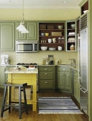 The Soft, Green Painted Cabinets Give This Kitchen An Inviting Country  Feel. The Bold Pop Of Yellow On The Center Island Complements A Similar, ...
