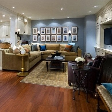 Finished basement ideas 10 total makeovers bob vila for Best flooring for basement family room