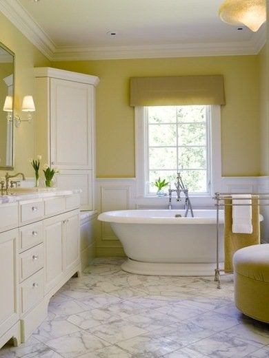 the peaceful quality of pale straw combined with white is undeniable elegant details in this serene setting include thick ceiling molding glass knobs on - Bathroom Paint Ideas