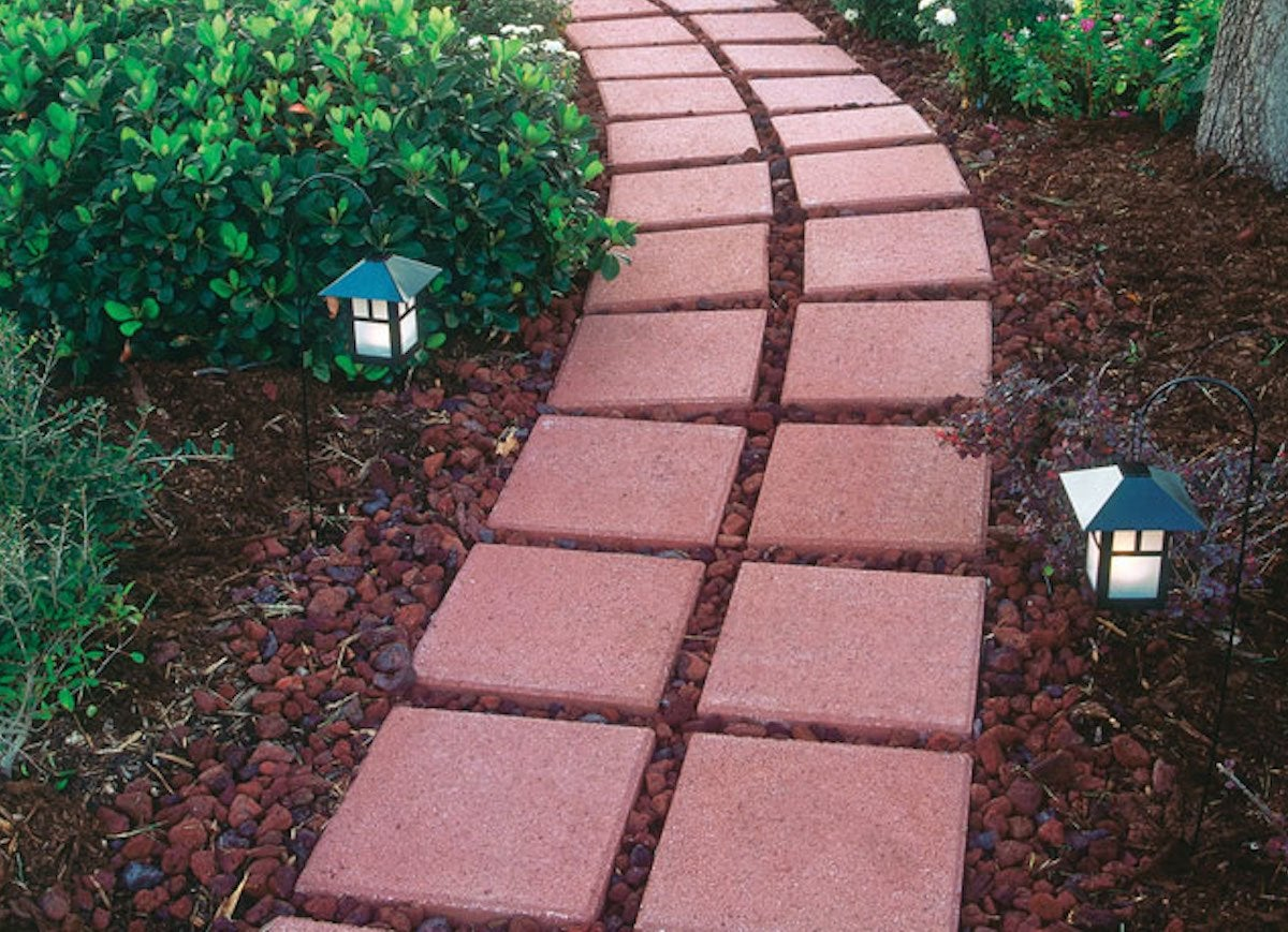 Stock Pavers Are Inexpensive And Readily Available At Most Hardware Home Supply S But They Re Not Exactly Exciting Surround Them In A Cut Out Bed